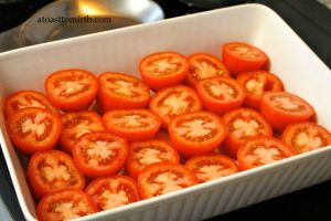 Step 1 - halved tomatoes in shallow baking dish